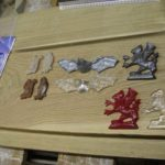 Several castings with different resin pigments and metal powders.