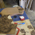 Walnut burr veneer being cut ready to let in